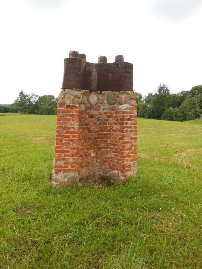cast iron top, brick middle, stone foundation.